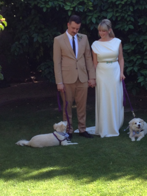 Tim and Deanne on their wedding day with Chicken Noodle and Foxie.