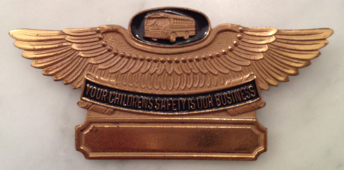 Winged school bus pin