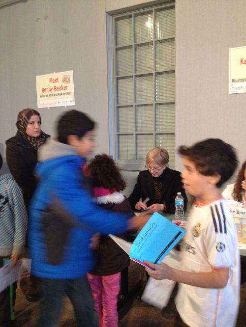 Kady signing autograph books.