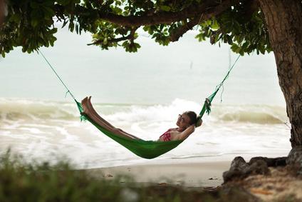 Beautiful women in the hammock on the beach