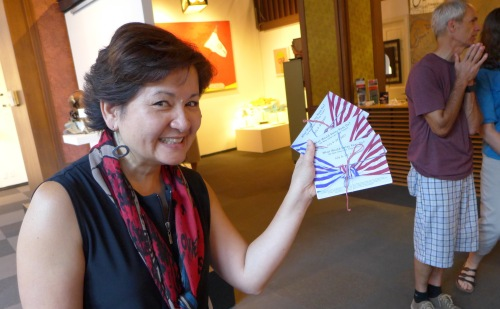 Cora Edmonds at What Would Betsy Ross Do? exhibit with postcards